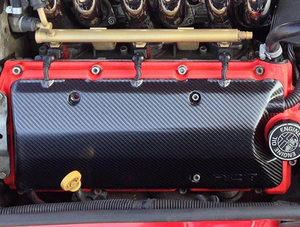 Carbon fibre V6 plug cover
